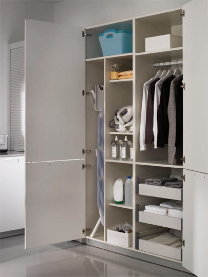 SANTOS kitchen | Solutions for the laundry    Ironing unit. This cupboard consists of two modules destined specifically to store everything to do with the ironing. One module contains the iron and the ironing table. The other module is designed to help organize the clothes, it contains drawers to put the already ironed clothes and a metallic bar to hang the ones that need it.