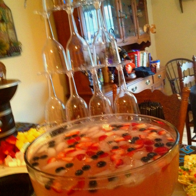 Wine punch!! Yummy!  2 bottles of arbor mist mango strawberry moscato 1 pink lemonade concentrate  1/4 of 2 liter of sprite Blueberries  Sliced strawberries
