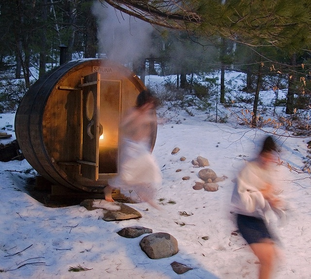 Barrell Sauna....these people running cracks me up. I think they are running to the hot tub...lol