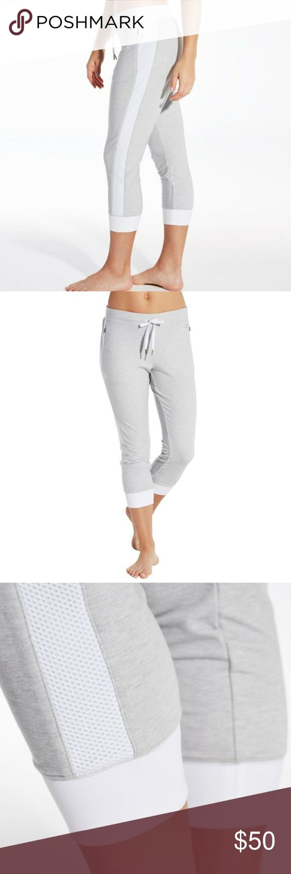 NWOT Calia Limited Edition Bahia Capri Joggers Comfort meets modern style with the CALIA™ by Carrie Underwood Women's Limited Edition Bahia Effortless Jogger Capris. These soft bottoms offer an easy, comfortable wear, while performance elements keep you dry and fresh. Mesh panels offer breathable style, zip pockets secure your small items, and a wide drawcord waistband provides a custom fit. Stay cozy and fashionable in the CALIA™ Limited Edition Bahia Effortless Jogger Capris. - removed…