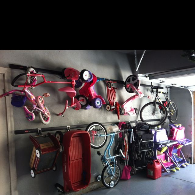 Stroller/Bike/Ride-on toy Storage Solution- we installed the Rubbermaid fast track storage system in our garage. Easy to mount the tracks into studs... Then just clip the adjustable hooks on. Bonus feature- we can now park in our garage! Total cost $225.