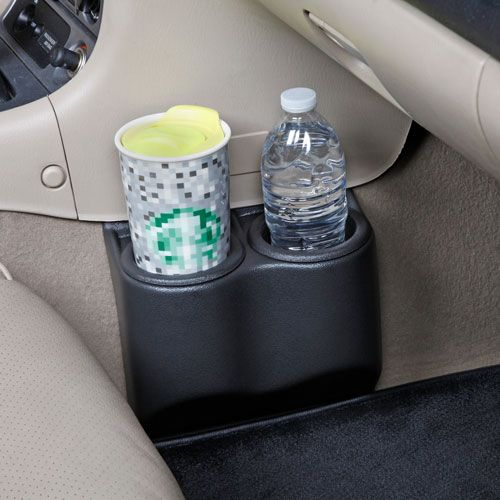 """Shifting your second gen """"NB"""" Miata with a cup in the OE cup holder is uncomfortable and can get messy if you aren't paying attention. A Miata enthusiast found a solution online built for Corvettes and made it work in his Miata. The manufacturer got wind of the Miata need and retooled the part to fit Miatas - and here we have the final product. This is a NO TOOLS installation, simply slip the top tongue under your plastic console and use your floor mat to anchor the bottom tongue."""