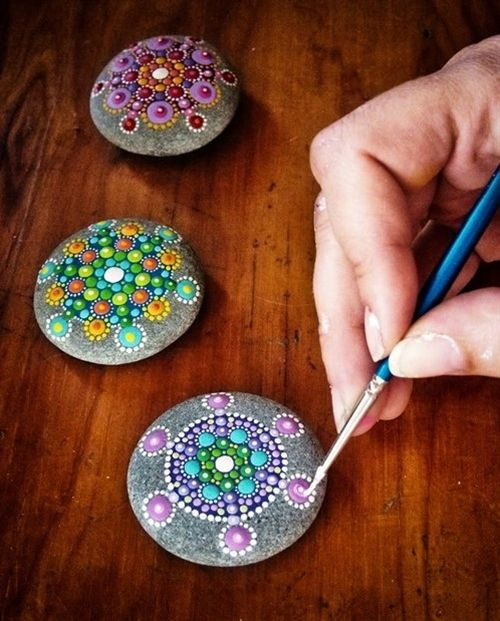 Gotta try this: Acrylic paint (enamel works even better, but its more expensive) on a few smooth rocks. So pretty!