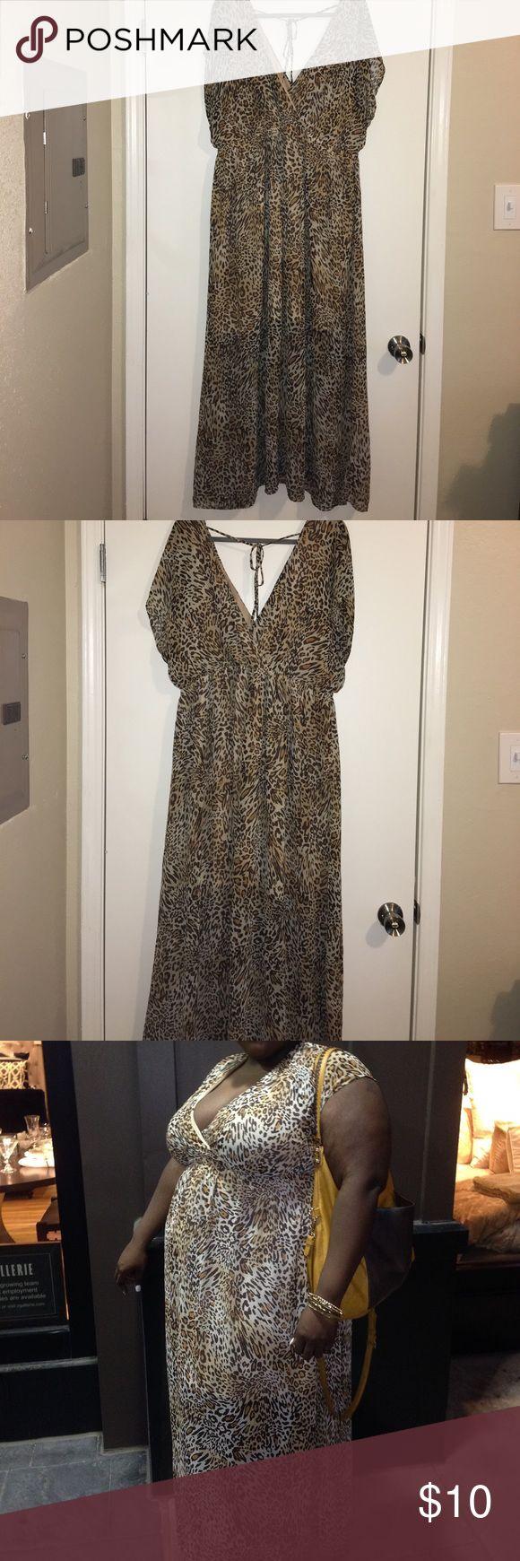 Leopard print empire waist sundress size 3X Forever 21 leopard print sundress with see through bottom. This dress has been worn. Forever 21 Dresses Maxi