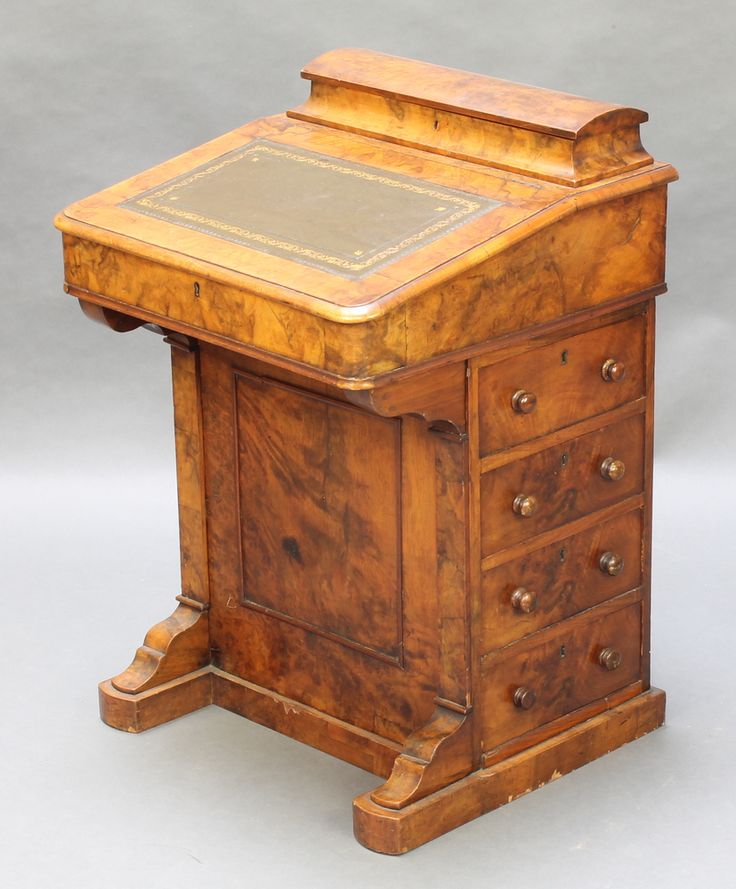 """Lot 1052, A Victorian figured walnut Davenport with stationery box to the top, the pedestal fitted 4 drawers 30""""h x 21""""w x 20""""d est £250-300"""