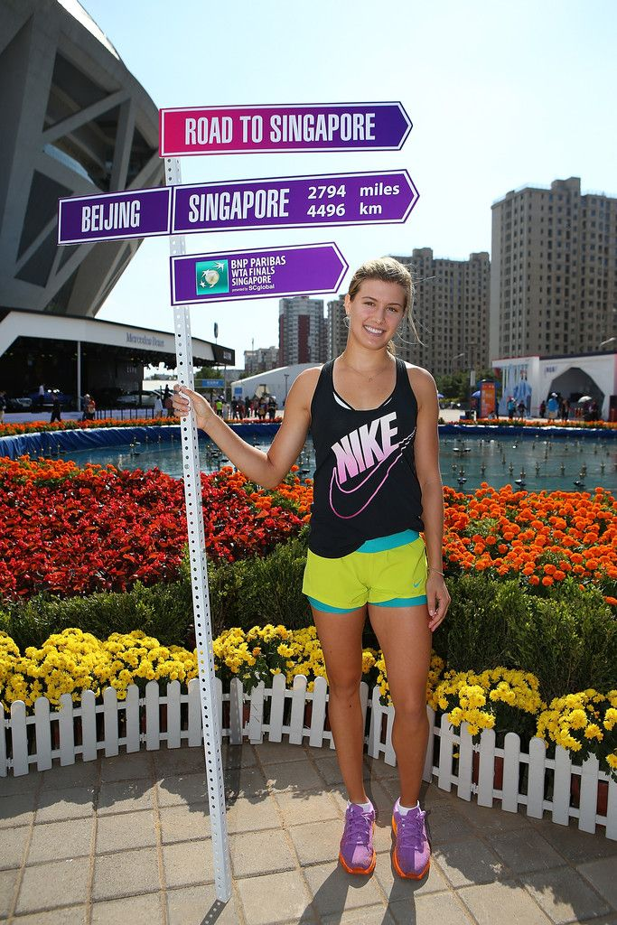 Eugenie Bouchard Photos: China Open: Day 3. Eugenie Bouchard of Canada poses with the Road to Sinagapore sign on day three of the China Open at the China National Tennis Center on September 29, 2014 in Beijing, China.