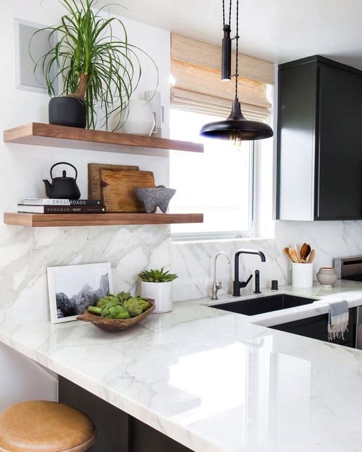 """Loving this kitchen and those simple hardwood shelves. Marble and wood creating a totally modern and organic look. Perfection! #kitchenperfection #kitchen…"""