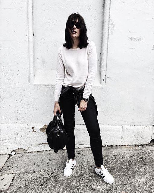 @Whiteandcapsule pairs our ADRIANA Black Gold Reform skinny jean perfectly with our ELKE sweater in Winter White