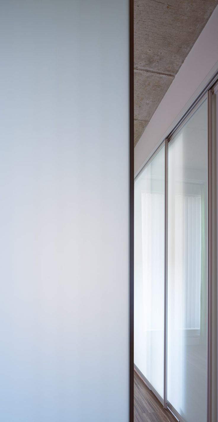 Sliding glass room dividers are great for small spaces where a traditional door doesn't work!
