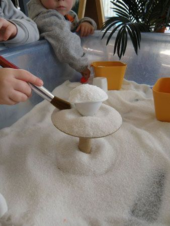 salt in the the sensory table---really like the idea of using a brush
