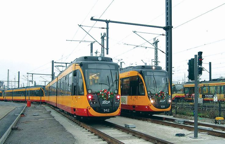 The Karlsruhe Stadtbahn is a German tram-train system combining tram lines in the city of Karlsruhe (750V DC) with railway lines in the surrounding countryside (15'000V AC) - Picture shows first two tram sets on Stadtbahn-Nord in Heilbronn. Courtesy AVG