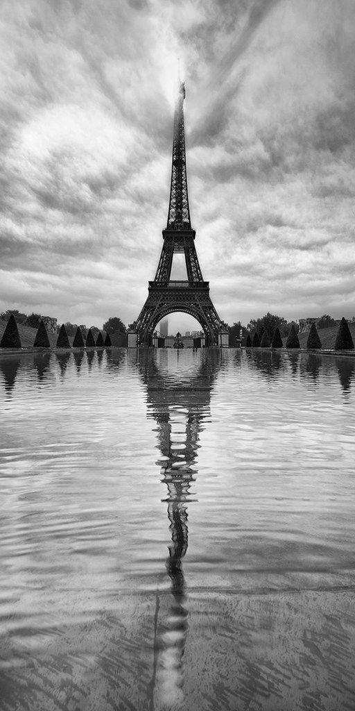 """Lee Sie - Le Paris Photograph """"The Eiffel tower is one of Europe's most photographed icon. I was looking all over the place to capture it in a different perspective that was not or at least not very often shot before. """" –Sie"""