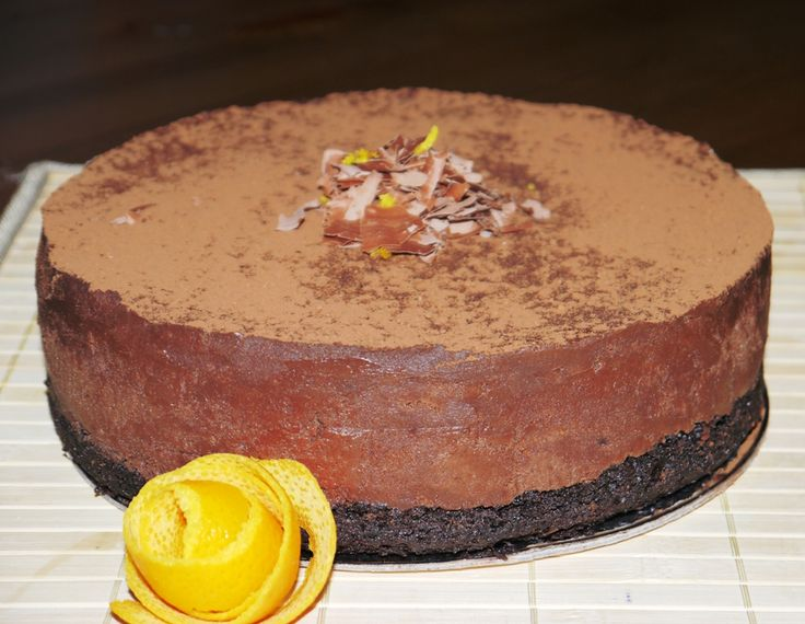 A dark chocolate torte with orange set on a rich chocolate fudge sponge base. Finished with a dusting of cocoa powder. Ideal dinner party dessert. Serves 12