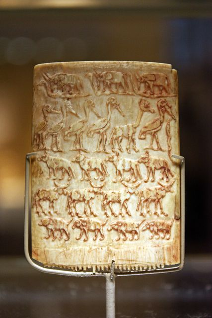 ca. 3200–3100 BCE. Ornamental Ivory Comb Predynastic, Late Naqada III, Egypt. Animals process in horizontal rows on both sides - a format continued in later Egyptian art. The arrangement and choice of animals were not haphazard. Elephants treading on snakes may be symbolic as many African peoples associated elephants and serpents with the creation of the universe. Other animals shown: wading birds, a giraffe; hyenas; cattle; and perhaps boars. MET