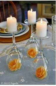 You can change the height of your candles or use the flower of your choice -- elegant, inexpensive and simple to put together -- I love this versatile idea!