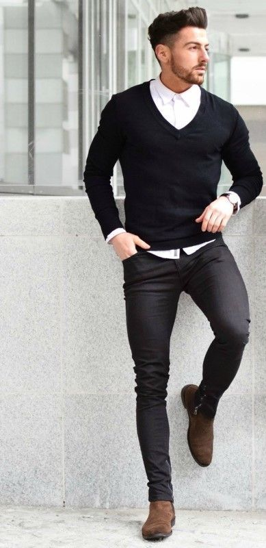 This combo of a black v-neck jumper and black slim jeans will enable you to keep your off-duty style clean and simple. Polish off the ensemble with brown suede chelsea boots.   Shop this look on Lookastic: https://lookastic.com/men/looks/v-neck-sweater-dress-shirt-skinny-jeans/22744   — White Dress Shirt  — Black V-neck Sweater  — Black Leather Watch  — Black Skinny Jeans  — Brown Suede Chelsea Boots