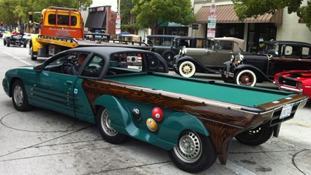 Pool table car. The back section detaches to form a regulation pool table.