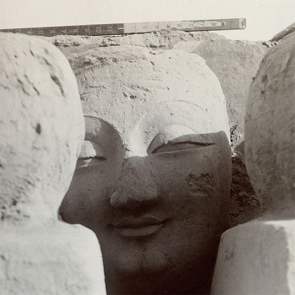 Colossal head of buddha, photographed by Aurel Stein at Miran II, 1907. Photo 392/26(239).