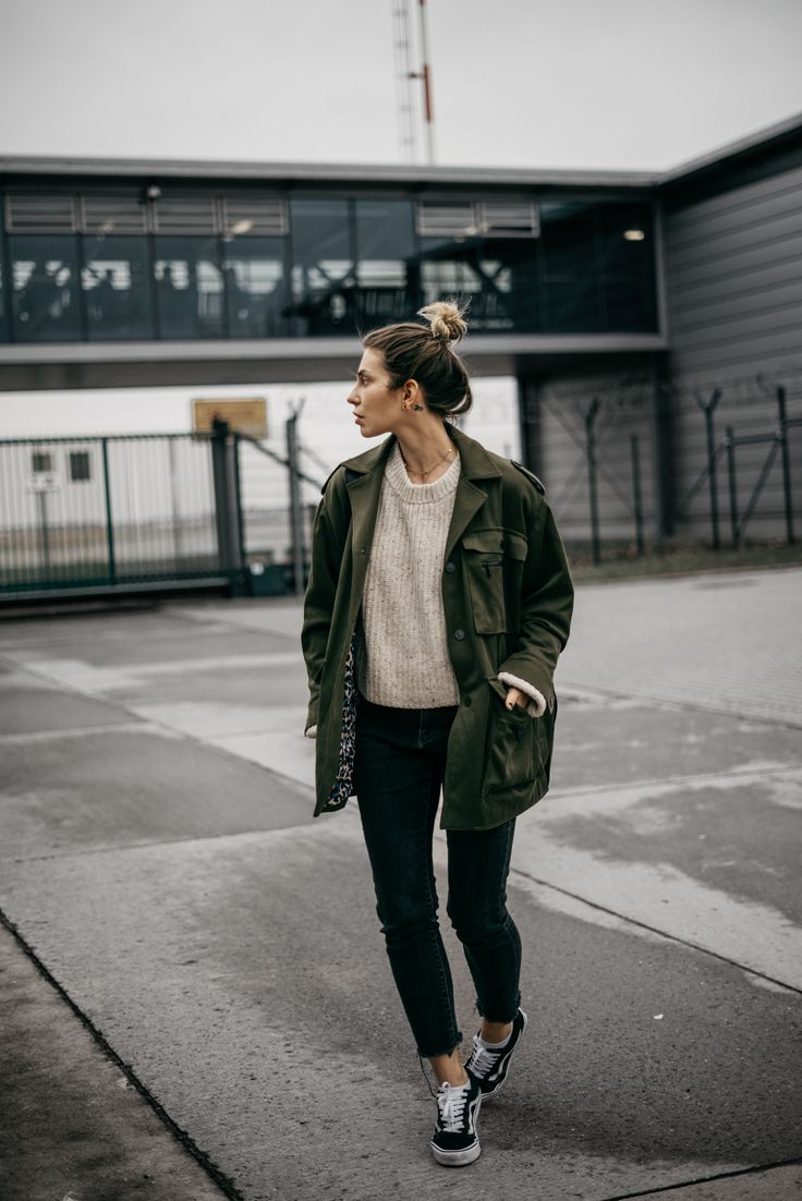 Ivory sweater+black cropped jeans+black sneakers+khaki army style parka+gold necklace. Winter To Spring Casual Outfit 2017
