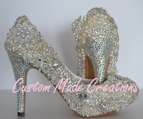 'Mia' is a unique design of crystals, pearls & flower embellishments.  'Mia'  is pictured in a 4 inch heel pump style shoe.    Crystal colours shown are 32, with ivory pearls & flower embellishments .    Want your very own custom pair created just for you?  Contact us with your special requirements & we will do our best to accommodate your needs.    OUR SHOES ARE COMPLETELY CUSTOMISABLE    Choose your heel height, shoe style, design, colours & embellishments.