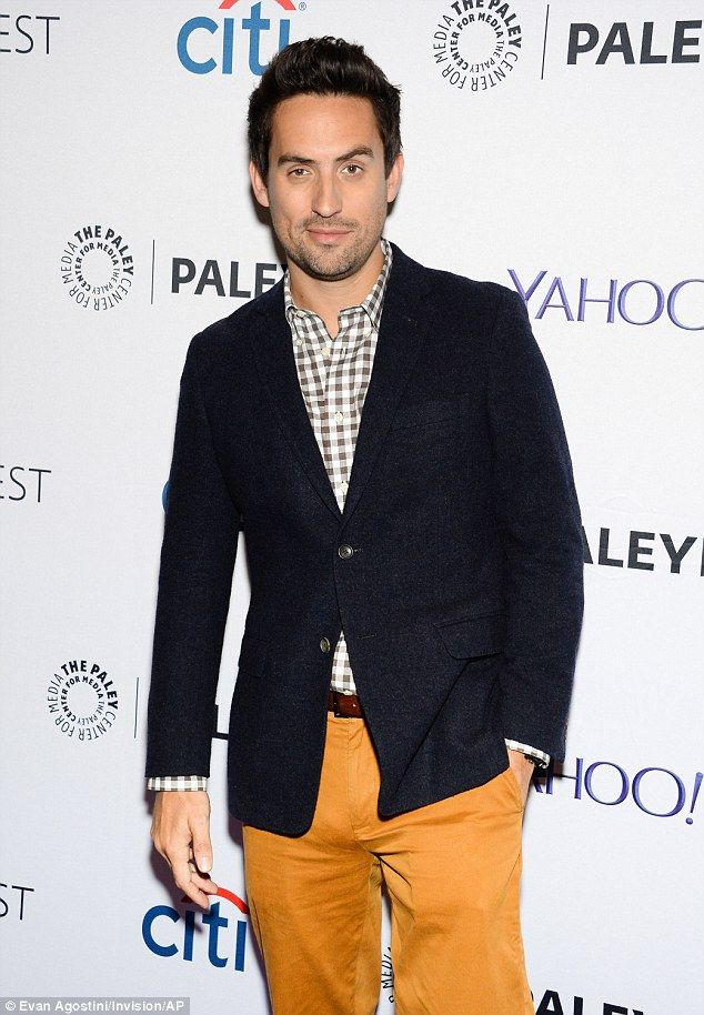 Man of style: Weeks looked sharp in mustard yellow trousers, a plaid shirt and a crisp black jacket