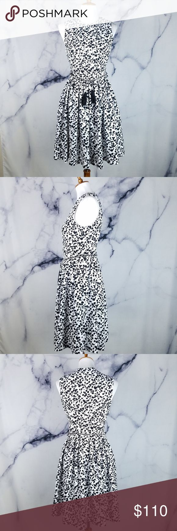 Karl Lagerfeld Paris Dress 6 Black White Leaves Gorgeous black and white floral/stick/leaves all over print, classic neckline, hidden back zipper closure, sleeveless, pleated skirt, tassel chain belt, a-line dress made by Karl Lagerfeld Paris in women's size 6. In great previously owned condition - no flaws. Please see pictures for details.  Approximate Measurements:  Armpit to Armpit: 16.5 inches (flat lay) 33 inches around Waist: 14 inches (flat lay) 28 inches around Length: 38 inches  If…