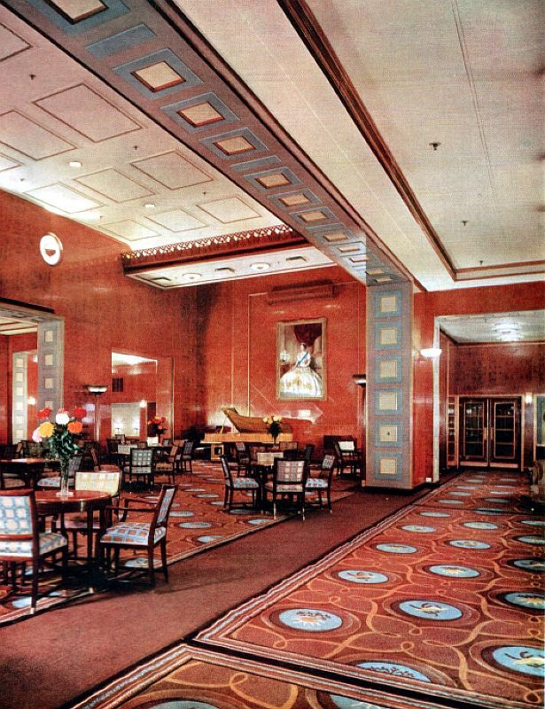 RMS Queen Elizabeth - 1939 - The Main Lounge has been re-carpeted, and all upholstery has been renewed with a new bandstand added and air-conditioning enhanced
