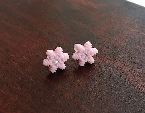 Tiny ice pink snowflake stud earrings handmade from polymer