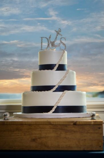 Nautical Wedding cake. Rope fondant, navy ribbon, wooden dock for stand, anchor cake topper. Nutella and fudge filling= delicious! Yes, this was my cake!
