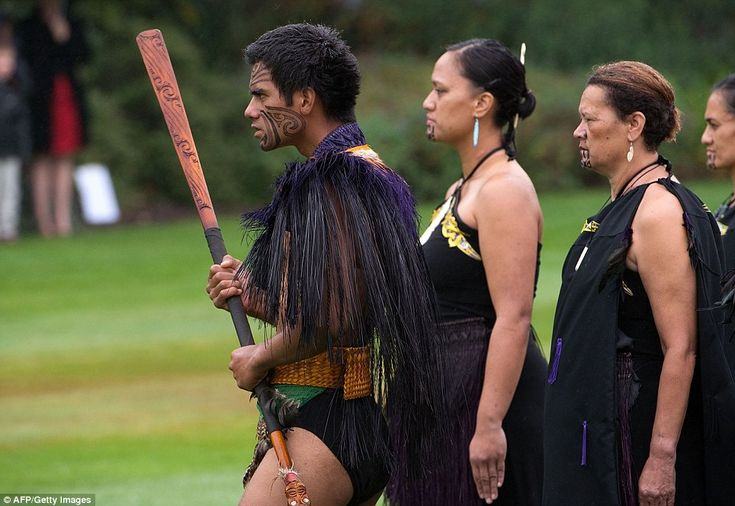 Ta Moko tattoos: A young man led a host of traditionally dressed locals onto the lawn. His face was covered in Maori Ta Moko patterns