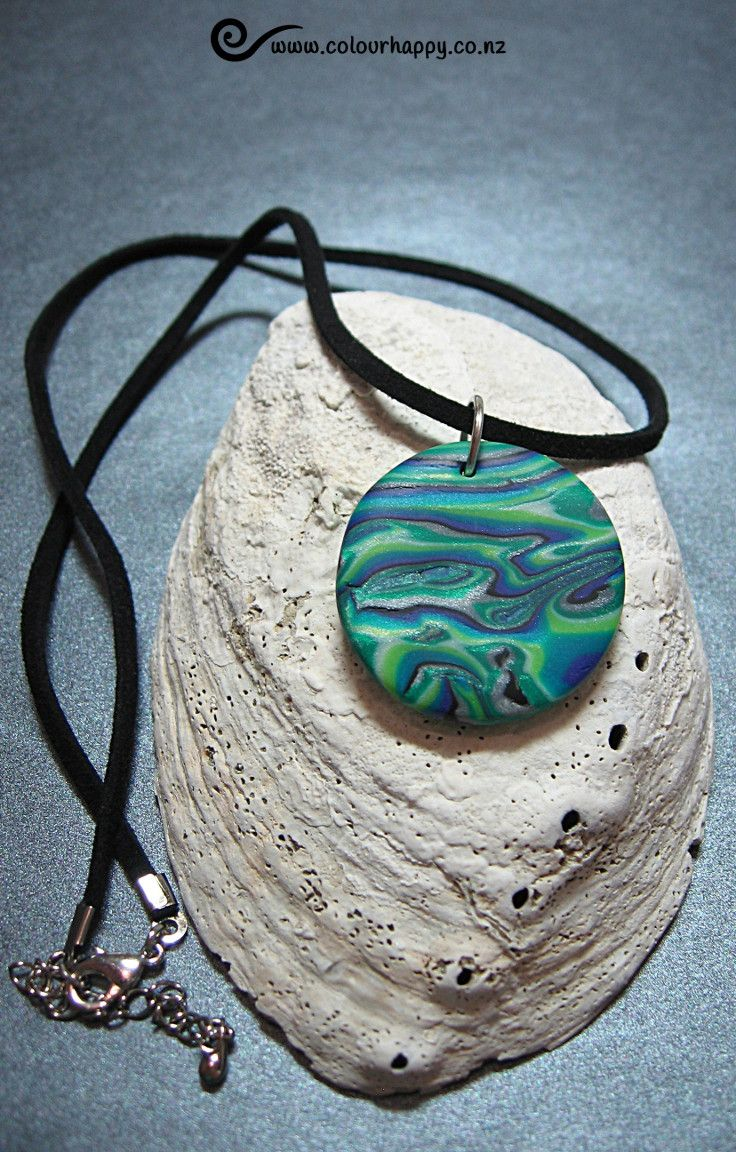 Inside the NZ paua shell (abalone) there is a beautiful iridescent pattern. I've tried to create a similar effect with shimmering swirls of blue, green, teal, silver and black. ♥Handmade polymer clay jewelry by Colour Happy / Adele