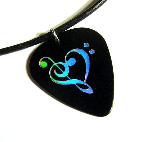 Guitar pick necklace - I WANT. I've been wanting a piece of jewelry with a music note on it, because music has become a major part of my life...completely changing it for the better. So I've wanted something I could wear all the time that signifies how important it is to me. I really like jewelry made from guitar picks too, so this is perfect. Especially with the music notes forming a heart <3 I love this so much.