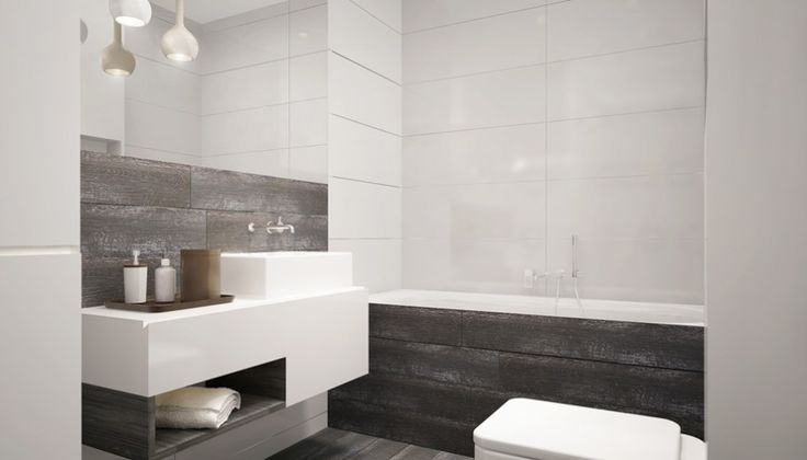 A modern bathroom with wood-look porcelain tile mixed with glossy white tile. Modern pendant lights hang above the two tier vanity across from the toilet.