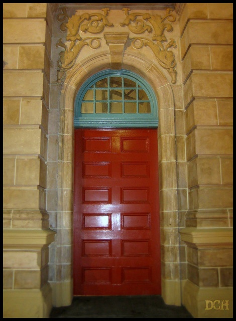 Ornate  Ornamental door on the exterior of Fremantle Railway Station.  Fremantle, Western Australia.