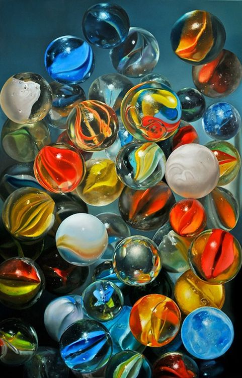 Love the marbles here - we called regular ones Marbles or Agates, those shown are mostly Cat's Eyes. The large solid coloured ones were called Boulders, Peewees were small ones. Some were made of glass.