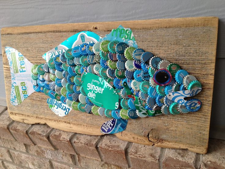 SOLD More art from THE Hot Florida Sun, Mexican Sea PROJECT... | The Moore Family Folk Art Blue bottle cap Fish by Folk Artist Alan Moore. Steel soda cans from the 1970s and bottle caps from 60s, 70s and 80s. 90 year old barn wood. SOLD