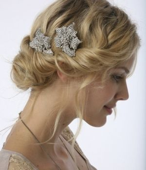 I like this side-twist thing with a few pieces out... but mine would go flat! My hair has a HARD time staying curly... -K