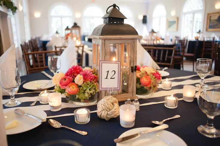 Wood lantern centerpieces with monkey knot table number | Coral & Navy Vintage Inspired Nautical Wedding At The Ribault Club Jacksonville Florida | Photograph by Britney Kay Photography   http://storyboardwedding.com/vintage-nautical-wedding-ribault-club-jacksonville-florida