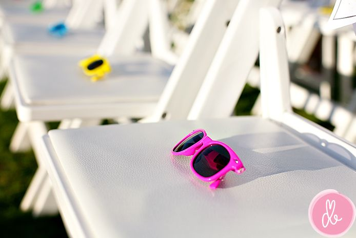 Colorful Sunglasses for guests! A great way to keep guests comfortable at a summer wedding.