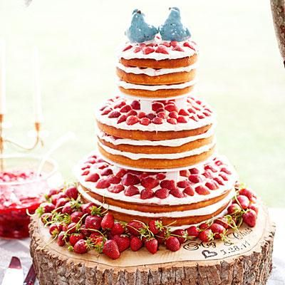Strawberry Shortcake | For a bride who doesn't like cake, a tiered shortcake (made from her grandpa's pound cake recipe!) layered with fresh strawberries and a creamy filling was the perfect choice. | SouthernLiving.com