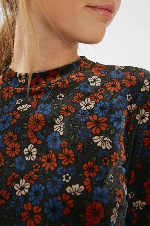 We love the details of this cute ditsy dress. Finished in a luxe velvet-style texture, the dress comes in an all-over floral print with long sleeves – perfect for taking into the new season. #Topshop