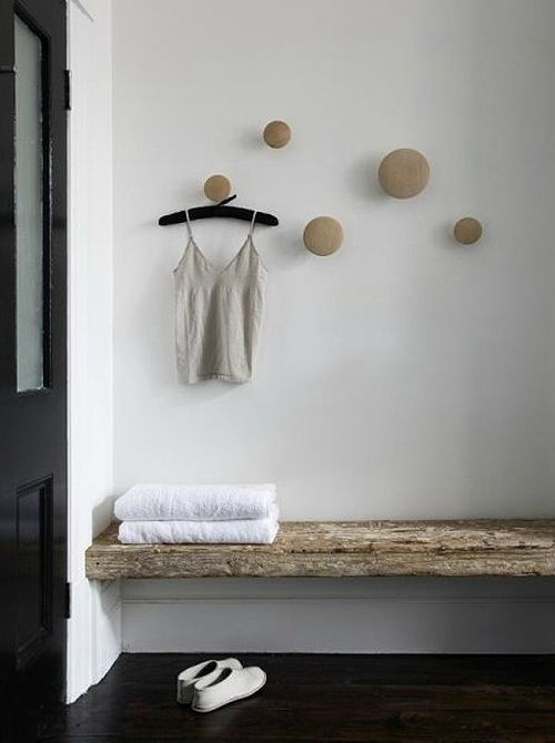 Varied sizes of wooden knobs used as hooks. Australian home of Carole Whiting.