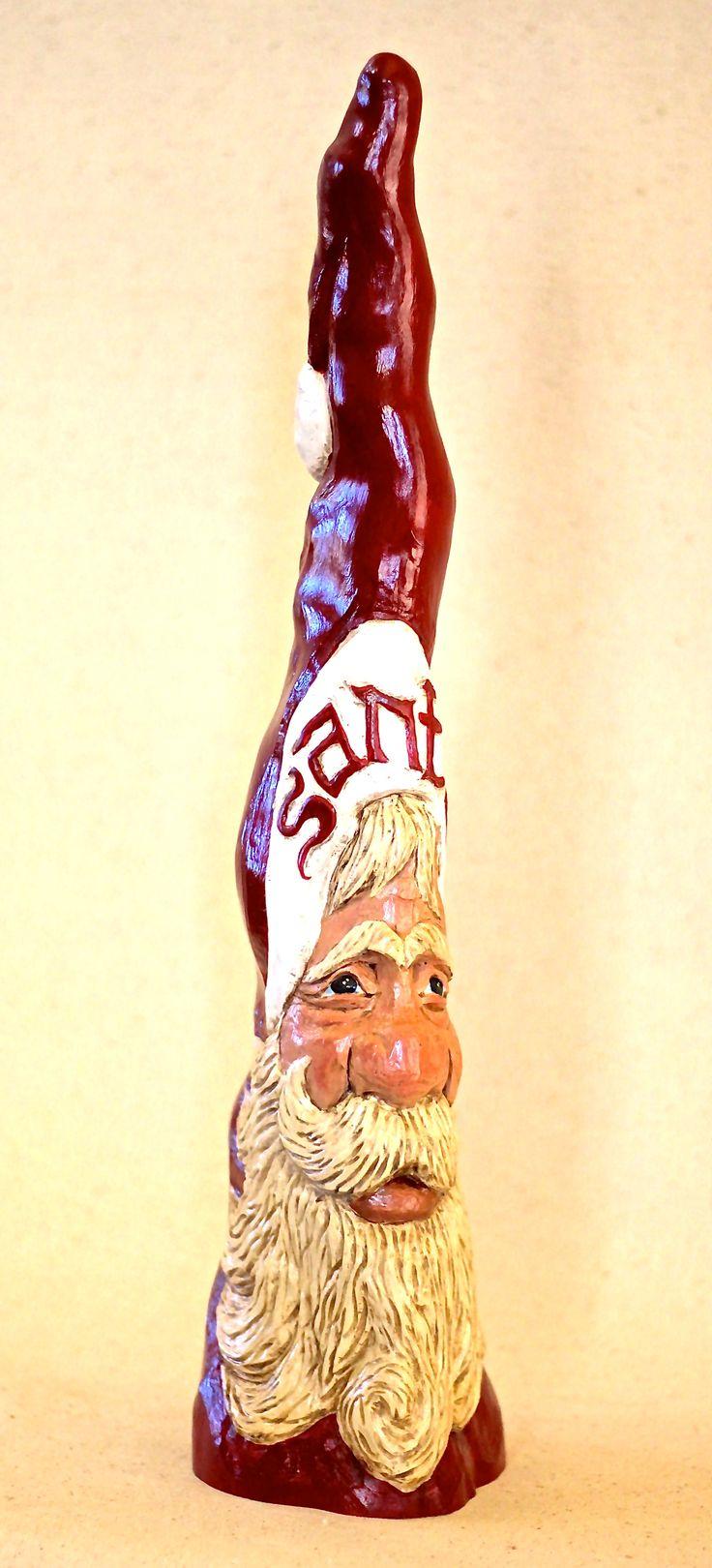 KATHY RAVENBERG, Artist.  Cypress Knee Santa.  Hand carved.