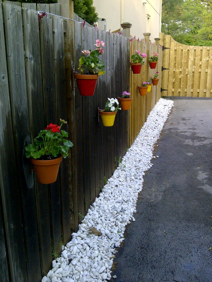Fence Makeover   White Stones, Terracotta Pots, Spray Paint, Potting Soil  And Plants