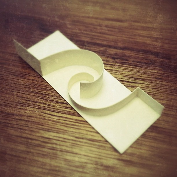 Minimal maze. One card folding sculpture.