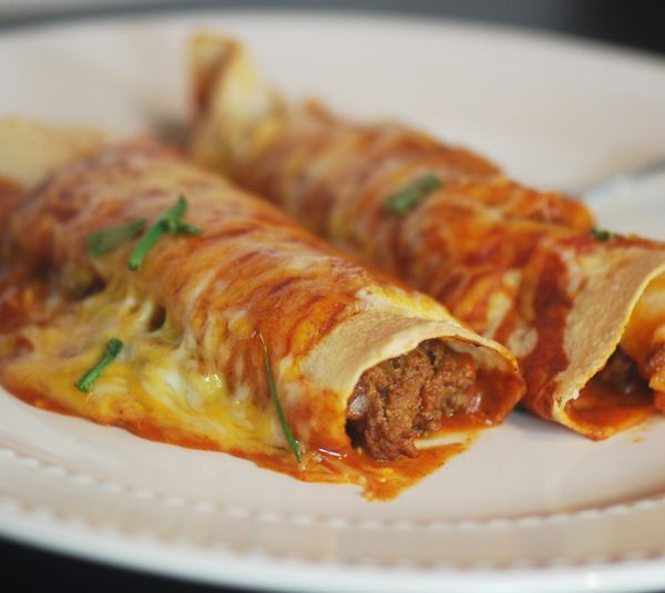 These are a perfect weeknight meal. They were super easy to pull together, and are a great comfort meal. The serving size is a little small (only one 6in enchilada), but the recipe is very generous with the cheese, so I can't complain too much! :) We'll be adding these to our dinner staples! (Beef Enchiladas- 8PP) ekw