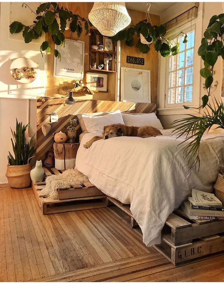 This is the perfect bedroom with natural wood, creamy colors and lots of greenery.