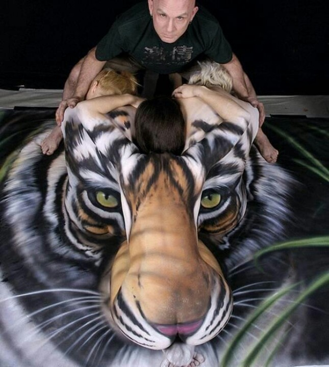 girls painted to form the tiger's head