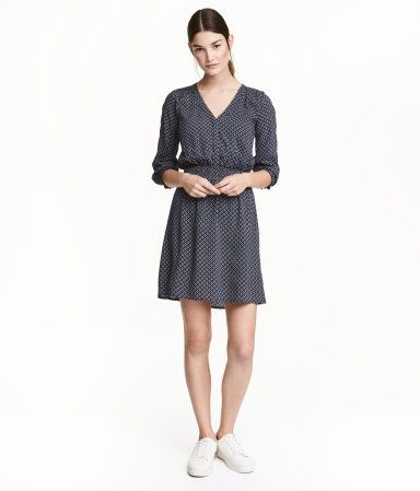 Dark blue/patterned. V-neck dress in woven viscose fabric with a printed pattern. Concealed snap fasteners at top, 3/4-length sleeves with smocking at cuffs
