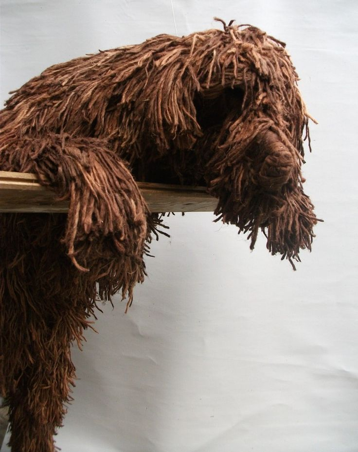 Big Brown Dog a Rope Sculpture by Dominic Gubb, Made to order.....This dog was commissioned by a client to fit into a precise space at their home. Big Brown Dog now puts a smile on the face of everyone who climbs the stairs as his loveable face peers cheerily over the bannister! .....Colours and size can vary to suit your preference. .....Contact us for details. .....(http://www.dogsinart.com/big-brown-dog-a-rope-sculpture-by-dominic-gubb/)